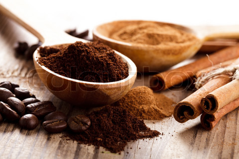 coffee-beans-and-cinnamon-milled-closeup-in-wooden-spoons